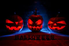 The concept of Halloween. Three glowing with fiery light of evil royalty free stock images