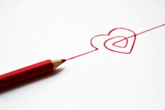 Concept hand drawn heart with pencils Stock Photos