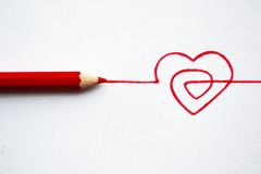 Concept hand drawn heart with pencils Royalty Free Stock Photos
