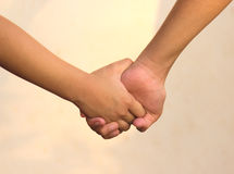 Concept,hand in hand,Holding hands together. Concept,finger,hand in hand,Holding hands together Stock Photo