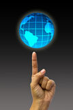 Concept hand pointing earth globe. Stock Photo
