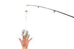 Concept of hand reaching for money casted as bait on fishing lin Stock Images
