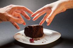 Concept with hands and chocolate cake Stock Images