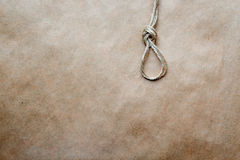 Concept hangman's knot on kraft paper background Stock Images