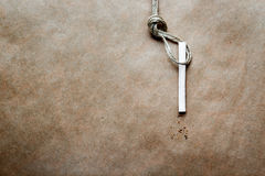 Concept hangman's knot on kraft paper background with cigarette Stock Photo