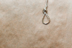 Concept hangman's knot on kraft paper background soft light Royalty Free Stock Photo