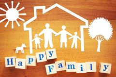 Concept of Happy Family at Home. Paper cuttings and wooden cubes. On a desk stock photography