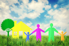 Concept of happy family near their  home outdoors. Against blue sky Royalty Free Stock Images