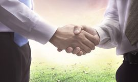 International Human Solidarity Day concept: Businessman shaking hands stock images