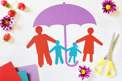 Concept of happy traditional family in safety Stock Images