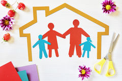 Concept of happy traditional family in their own home Stock Photography