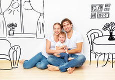 Concept : happy young family in new apartment dream and plan interior. Concept family: Happy young family in the new apartment dream and plan interior royalty free stock images