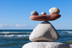 Concept of harmony and balance. Balance and poise stones. Concept of harmony and balance. Balance and poise stones against the sea. Rock zen in the form of Royalty Free Stock Photos