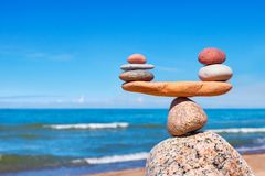 Concept of harmony and balance. Balance stones against the sea. Rock zen in the form of scales Royalty Free Stock Image