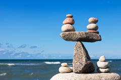 Concept of harmony and balance. Balance stones against the sea. Royalty Free Stock Photo