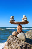 Concept of harmony and balance. Balance stones against the sea. Stock Photo