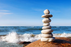 Concept of harmony and balance. High pyramid of white stones. Rock Zen in the background of the sea Stock Images