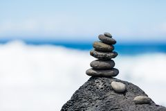 Concept of harmony and balance. Rock Zen on a background of rock. S, Reunion Island Stock Photos