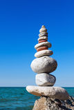 Concept of harmony and balance. Rock Zen on the background of summer sea Royalty Free Stock Photos