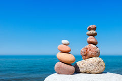Concept of harmony and balance. Rock Zen on the background of summer sea Stock Image