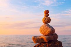 Concept of harmony and balance. Rock Zen at sunset. Balance and. Poise stones against the sea Stock Photography