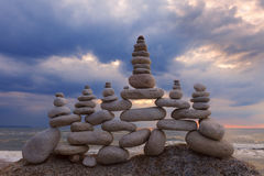 Concept of harmony and balance. Rock Zen at sunset. Royalty Free Stock Images