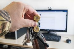 Hatred of the computer and modern technologies and loading a hunting or sporting classic smoothbore gun Stock Image