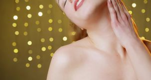 The concept of health and beauty. Body cream on the shoulders and neck of a woman with a moisturizing lotion that preventing dry skin on areas of the female stock video footage
