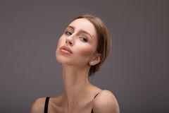 Concept health care and skin care. The woman has a clean well-groomed skin and long brown hair. Close-up portrait Royalty Free Stock Photos