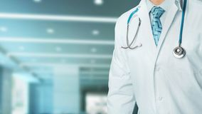 Concept of health and medicine. Confident professional doctor in white coat with stethoscope, portrait in clinic royalty free stock photography