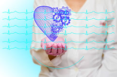 Concept of health and medicine - female doctor holding a red heart with gears with ecg lines. Concept of health and medicine female doctor holding a red heart royalty free stock images