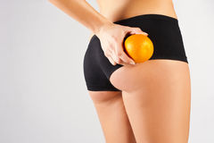 Concept of a healthy body. Beautiful bottom, fruit Royalty Free Stock Images