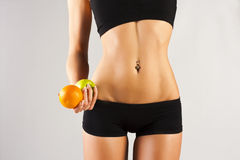 Concept of a healthy body. Thin belly, fruit Stock Photo