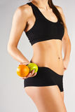 Concept of a healthy body. Thin belly, fruit Stock Photos