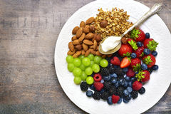 Concept of healthy breakfast : granola,nuts,fresh berries and yo. Gurt.Top view with copy space Stock Photo