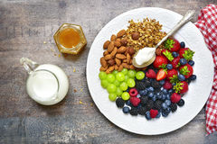 Concept of healthy breakfast : granola,nuts,fresh berries and yo. Gurt.Top view with copy space Stock Photography