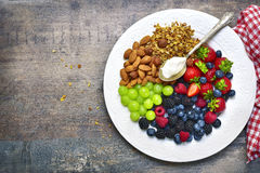 Concept of healthy breakfast : granola,nuts,fresh berries and yo. Gurt.Top view with copy space Stock Photos
