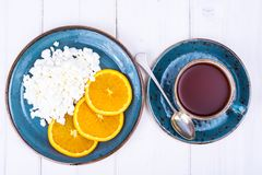 Concept of healthy dietary nutrition. Fresh raw cottage cheese with fruit, herbal tea. Studio Photo Royalty Free Stock Photography