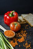 The concept of healthy eating. Balanced healthy eating background. Lentils, white bread, vegetables, greens on a dark wooden stock photos