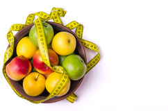 Concept of healthy eating, fresh apples in a plate and measuring Royalty Free Stock Photography