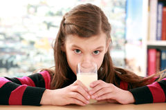 Concept healthy eating with a girl drinking milk Royalty Free Stock Images
