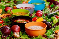 Concept of healthy eating or vegetarian food of colorful vegetables cream soups and ingredients for soup. Concept of healthy eating or vegetarian food of multi stock image