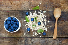 Concept: healthy food. blueberries and oat flakes Royalty Free Stock Photos