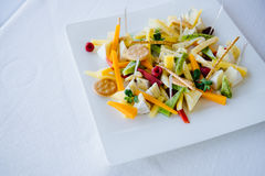 The concept of healthy food, fruit, cheese and crackers on the plate Stock Photo