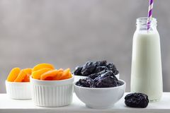 Concept healthy food, vegetarianism, diet. Yogurt, dried apricots and prunes in a white bowls royalty free stock images