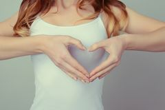 Concept of healthy heart, lifestyle and female health. Woman ma stock photo