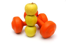Concept of healthy life with apples and weights Stock Photography