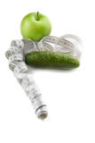 Concept of healthy lifestyle (cucumber and apple) Stock Photo