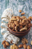 The concept of a healthy lifestyle, nuts  and measuring meter Stock Photos