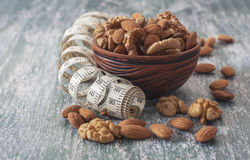The concept of a healthy lifestyle, nuts  and measuring meter Stock Images